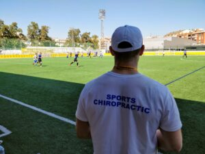 Josh French, sports chiropractor at a football pitch.