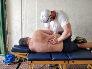 Josh French adjusting the low back to improve low back pain.