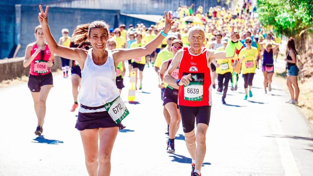 runners celebrating competing pain free after chiropractic treatment.